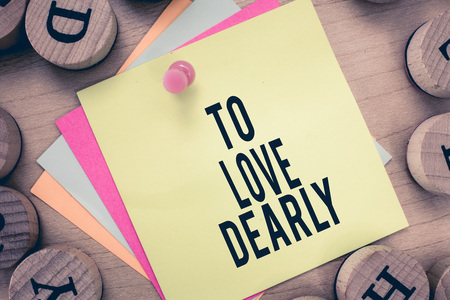 Text sign showing To Love Dearly. Conceptual photo Love someone very much in the more humble way and aimlessly. Imagens - 107593784