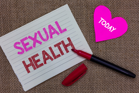 Handwriting text writing Sexual Health. Concept meaning Healthier body Satisfying Sexual life Positive relationships Piece notebook paper heart jute background open marker Communicating ideas