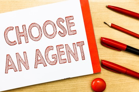 Handwriting text writing Choose An Agent. Concept meaning Choose someone who chooses decisions on behalf of you. Stock Photo