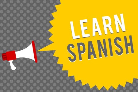 Handwriting text writing Learn Spanish. Concept meaning Translation Language in Spain Vocabulary Dialect Speech Megaphone loudspeaker speech bubble message gray background halftone