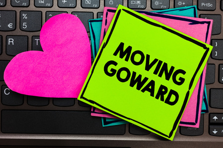 Text sign showing Moving Goward. Conceptual photo Towards a Point Move on Going Ahead Further Advance Progress Papers Romantic lovely message Heart Keyboard Type computer Good feelings