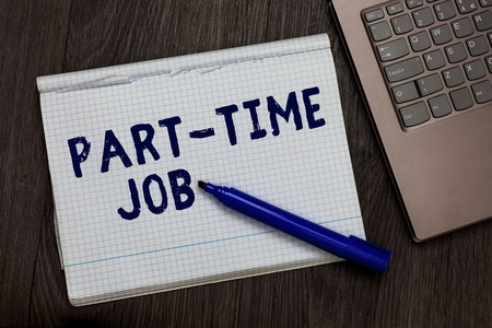Conceptual hand writing showing Part Time Job. Business photo text Weekender Freelance Casual OJT Neophyte Stint Seasonal Open notebook squared page black marker computer wooden background 写真素材 - 107673749