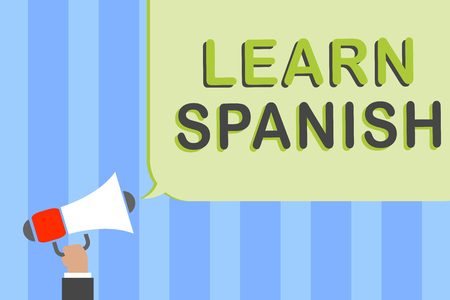 Writing note showing Learn Spanish. Business photo showcasing Translation Language in Spain Vocabulary Dialect Speech Man holding megaphone loudspeaker speech bubble message speaking loud