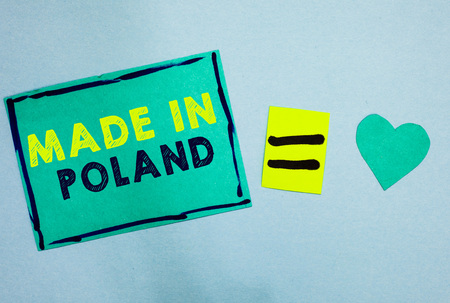 Handwriting text Made In Poland. Concept meaning A product or something that is manufactured in Poland Turquoise paper notes reminders equal sign important messages to remember