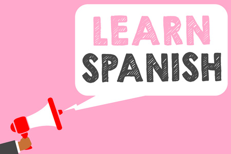 Text sign showing Learn Spanish. Conceptual photo Translation Language in Spain Vocabulary Dialect Speech Man holding megaphone loudspeaker speech bubble message speaking loud