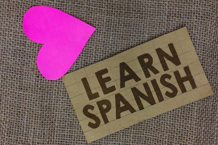Word writing text Learn Spanish. Business concept for Translation Language in Spain Vocabulary Dialect Speech Piece squared paperboard paper heart jute background Communicating ideas