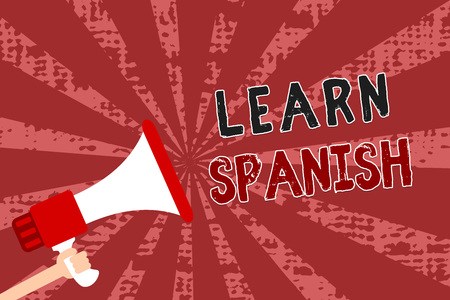 Word writing text Learn Spanish. Business concept for Translation Language in Spain Vocabulary Dialect Speech Man holding megaphone loudspeaker grunge red rays important messages Stok Fotoğraf - 107682509