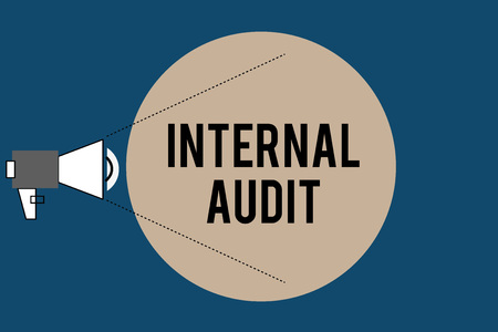 Handwriting text Internal Audit. Concept meaning Evaluates the effectiveness of the controls and processes.