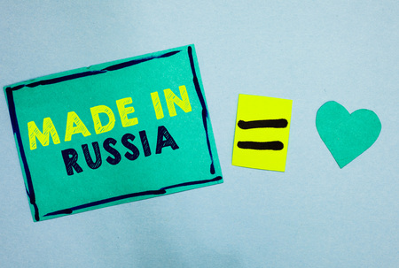 Handwriting text Made In Russia. Concept meaning A product or something that is manufactured in Russia Turquoise paper notes reminders equal sign important messages to remember 写真素材