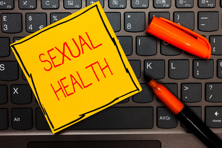 Writing note showing Sexual Health. Business photo showcasing Healthier body Satisfying Sexual life Positive relationships Yellow paper keyboard Inspiration communicate ideas orange markers Фото со стока