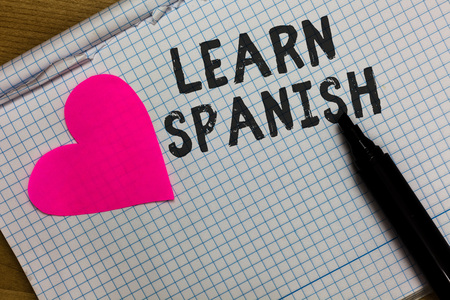 Text sign showing Learn Spanish. Conceptual photo Translation Language in Spain Vocabulary Dialect Speech Squared notebook paper ripped sheets Marker romantic ideas pink heart