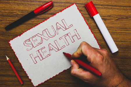 Word writing text Sexual Health. Business concept for Healthier body Satisfying Sexual life Positive relationships Man hand holding marker notebook paper expressing ideas wooden background Фото со стока