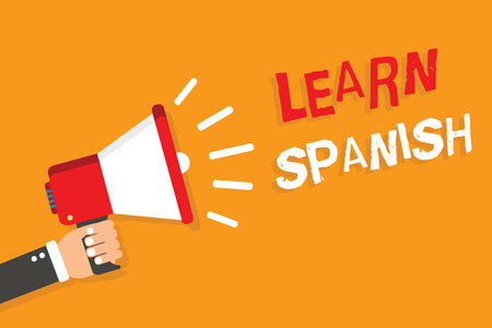 Conceptual hand writing showing Learn Spanish. Business photo showcasing Translation Language in Spain Vocabulary Dialect Speech Man holding megaphone orange background message speaking Stok Fotoğraf - 107751890