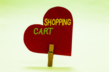 Writing note showing Shopping Cart. Business photo showcasing Case Trolley Carrying Groceries and Merchandise Clothespin holding red paper heart important romantic message ideas