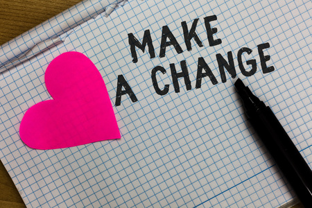 Text sign showing Make A Change. Conceptual photo Create a Difference Alteration Have an Effect Metamorphose Squared notebook paper ripped sheets Marker romantic ideas pink heart Stok Fotoğraf - 107751322