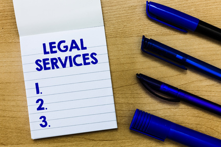 Writing note showing Legal Services. Business photo showcasing Providing access to justice Fair trial Law equality.
