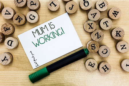 Writing note showing Mum Is Working. Business photo showcasing Financial Empowerment and professional progressing mother.