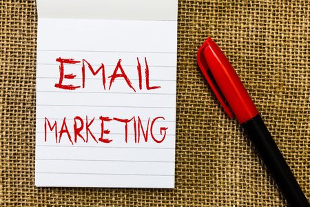 Handwriting text Email Marketing. Concept meaning Sending a commercial message to a group of people using mail. Stock Photo