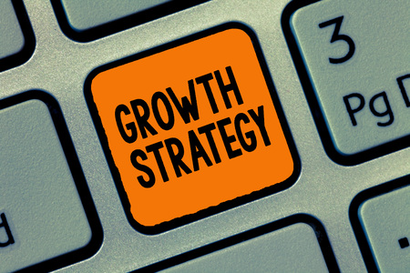 Handwriting text writing Growth Strategy. Concept meaning Strategy aimed at winning larger market share in shortterm.