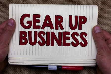 Handwriting text writing Gear Up Business. Concept meaning tool for assessing needs of idea and create plan Man hands holding notebook open page jute background Expressing ideas