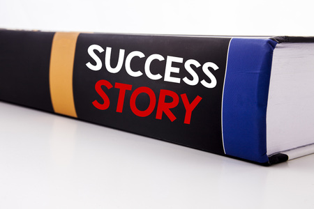 Conceptual hand writing text caption inspiration showing Success Story. Business concept for Inspiration Motivation written on the book the white background.