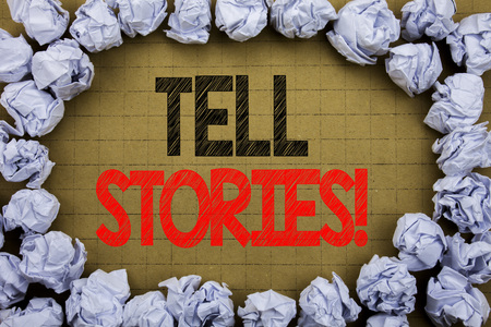 Tell Stories. Business concept for Storytelling Telling Story written on vintage background with space on old background with folded paper balls