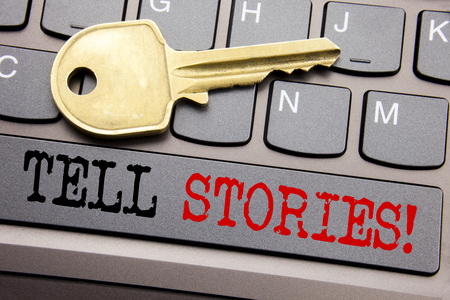 Hand writing text caption inspiration showing Tell Stories. Business concept for Storytelling Telling Story written on keyboard key on the key next to the text.