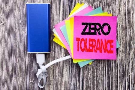 Zero Tolerance. Business concept for Policy For Punishment written on sticky note with space on old wood wooden background with power bank