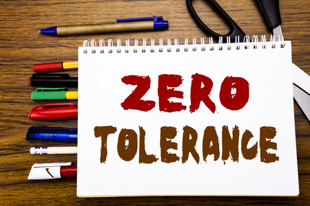 Word, writing Zero Tolerance. Business concept for Policy For Punishment Written on notebook, wooden background office equipment like pens scissors colourful marker