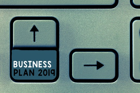 Writing note showing Business Plan 2019. Business photo showcasing Challenging Business Ideas and Goals for New Year. Stock Photo
