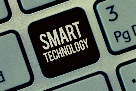 Writing note showing Smart Technology. Business photo showcasing gadgets or device that has a built in computer or chip. Stock Photo