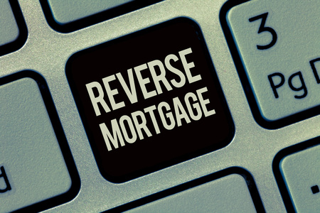 Writing note showing Reverse Mortgage. Business photo showcasing loan for seniors age above sixties and older to be returned.