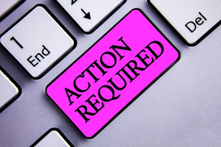 Writing note showing  Action Required. Business photo showcasing Important Act Needed Immediate Quick Important Task Text two words pink insert button key press on grey computer