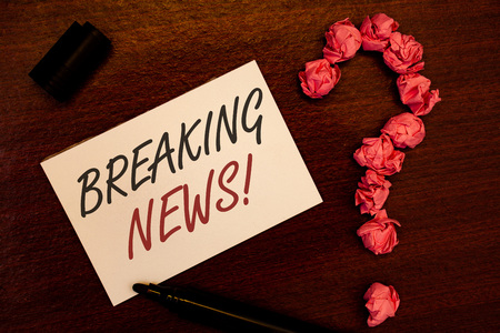 Text sign showing Breaking News Motivational Call. Conceptual photo Updated press report Latest information Text white paper note black marker open cap pink crumbled paper question