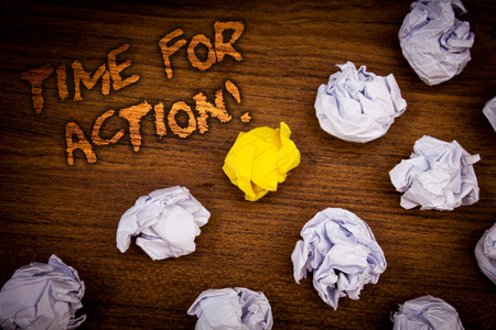 Conceptual hand writing showing Time For Action Motivational Call. Business photo showcasing Urgency Move Encouragement Challenge Work Words wooden desk crumbled white yellow paper Banque d'images