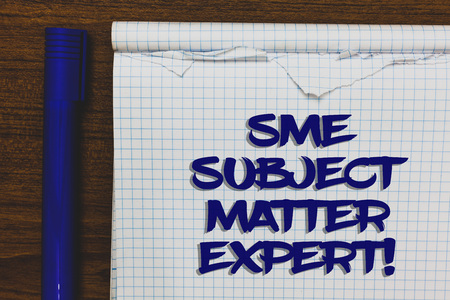 Writing note showing Sme Subject Matter Expert. Business photo showcasing Authority in a particular area or topic Domain Written white notepad on grey wooden background beside blue marker