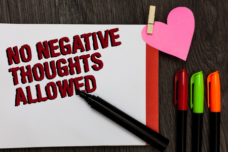Writing note showing No Negative Thoughts Allowed. Business photo showcasing Always positive motivated inspired good vibes Bold red words pen on page small heart corner pens laid serially