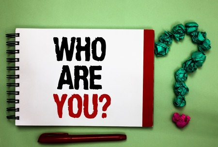 Writing note showing Who Are You question. Business photo showcasing Identify yourself description personal characteristics Celadon color background red sided notepad letters green query mark