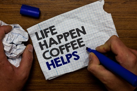 Word writing text Life Happen Coffee Helps. Business concept for Have a hot drink when having problems troubles Hand hold paper lob and blue marker wooden base with torn white written page