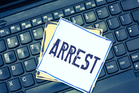 Handwriting text writing Arrest. Concept meaning seize someone by legal authority and take them into custody.