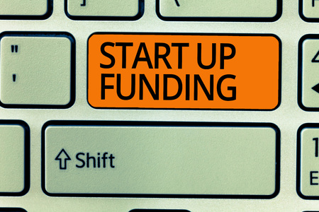 Writing note showing Start Up Funding. Business photo showcasing begin to invest money in newly created company or campaign. Stock Photo
