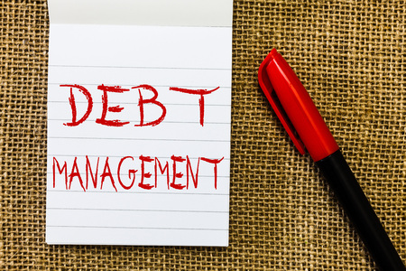 Handwriting text Debt Management. Concept meaning The formal agreement between a debtor and a creditor.