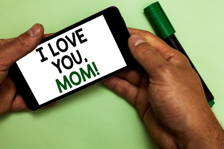 Writing note showing I Love You, Mom. Business photo showcasing Loving message emotional feelings affection warm declaration Human hand hold with texts touched green marker