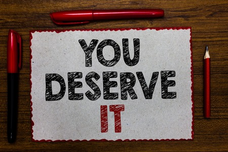 Text sign showing You Deserve It. Conceptual photo Reward for something well done Deserve Recognition award Red bordered white page centered some texts wooden desk pen pencil