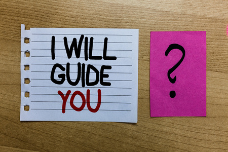 Conceptual hand writing showing I Will Guide You. Business photo text Help showing a route Influence to do or think something white page on wooden desk with words violet with question mark