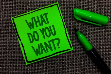 Writing note showing What Do You Want question. Business photo showcasing Tell me your desires requests demands ambition Black lined green sticky note with words open green pen on sack Stock fotó