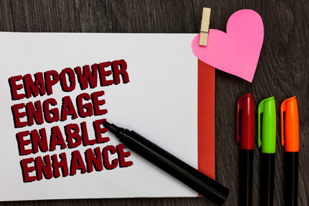 Writing note showing Empower Engage Enable Enhance. Business photo showcasing Empowerment Leadership Motivation Engagement Bold red words pen on page small heart corner pens laid serially