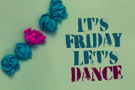 Writing note showing It s is Friday Let s is Dance. Business photo showcasing Celebrate starting the weekend Go party Disco Music Drawn blue and red words teal color paper lump mid pink on blue floor