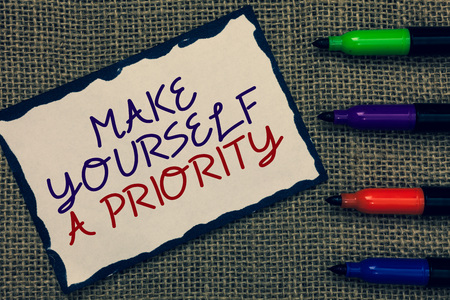 Text sign showing Make Yourself A Priority. Conceptual photo Think in your own good first personal development Blue bordered page drawn some texts laid color pen jute background