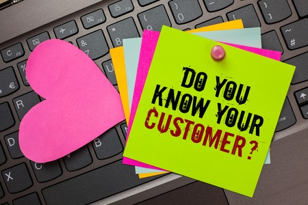 Text sign showing Do You Know Your Customer question. Conceptual photo Have into account client likes opinion Bright colorful written papers pinch by pin pink heart on computer keyboard Stock fotó